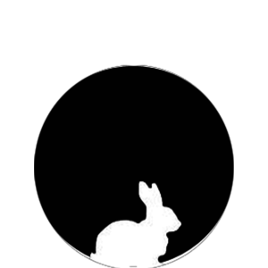 Tyrikes logo, a black circle with a white rabbit