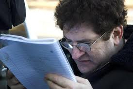 Picture of man with visual disability reading a script