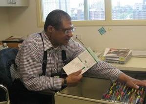 Jonathan sorting and filing paperwork