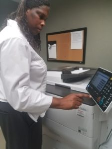 Picture of Thomasina operating a copy machine