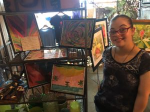 Allison displays her art work on the job at Stein's Florist