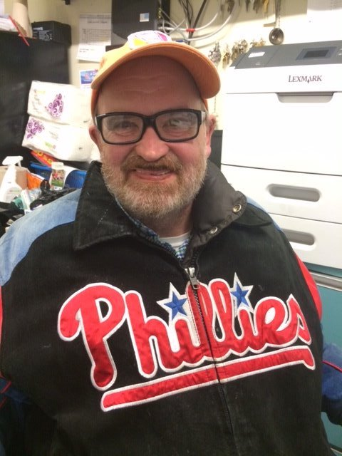 Picture of John wearing a Phillies jersey and hat
