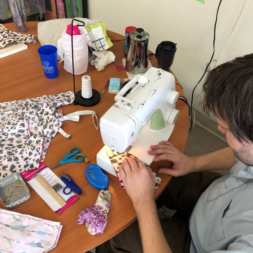 Picture of Jason working at sewing machine creating an item